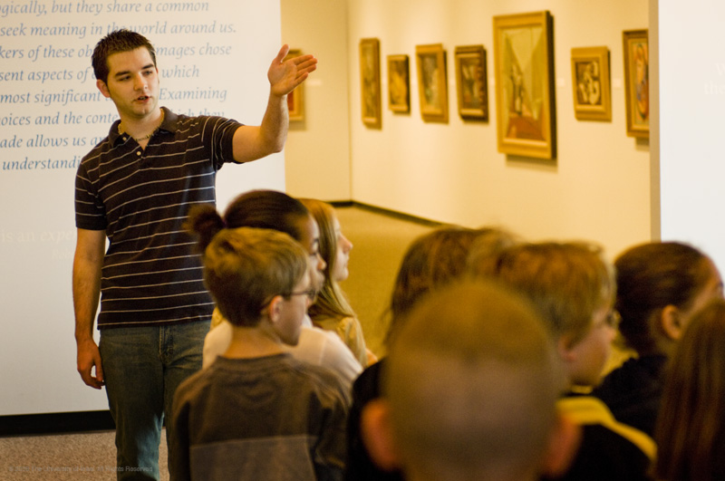 A student teaching young children about art
