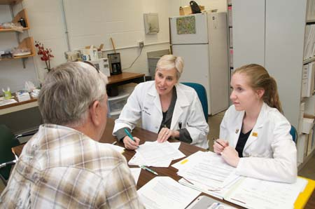 Two researchers with study participant