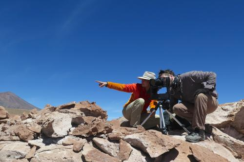 Ingrid Ukstins Peate and a student overlook the Laguna Lejia area.