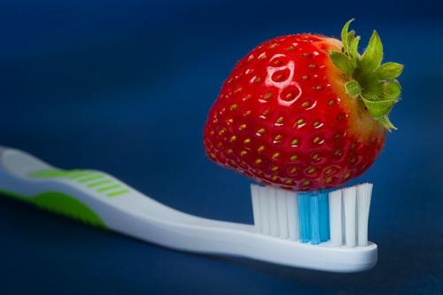 A strawberry on a toothbrush
