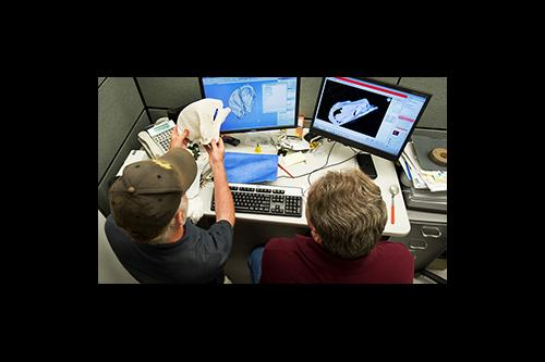 UI researchers work together on computers.