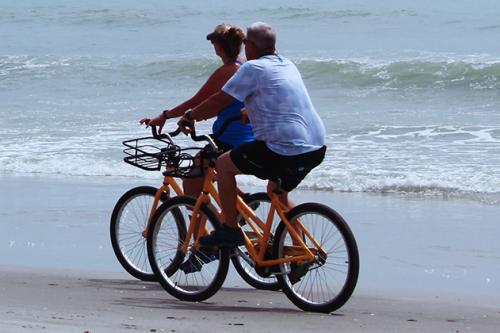 cyclists on beach