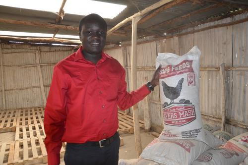 man holding bag of feed