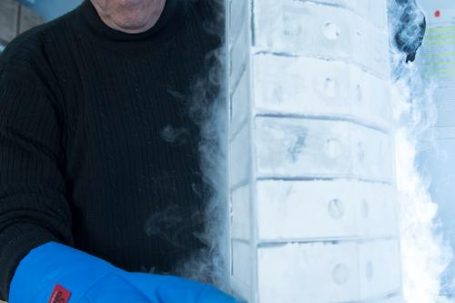 Portrait of researcher standing next to frozen protein samples