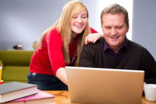 father and daughter at laptop