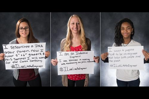 three female students in College of Engineering holding signs
