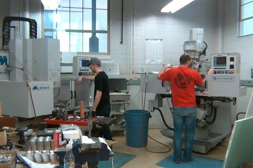Workers in the Engineering Machine Shop.
