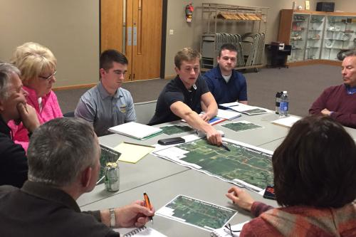 students discuss park plans with residents