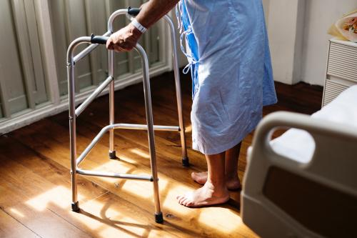 elderly man using a walker